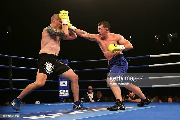 Paul Gallen throws a right at Randall Rayment during their heavyweight bout during the Footy Show Fight Night at Allphones Arena on January 31, 2015...