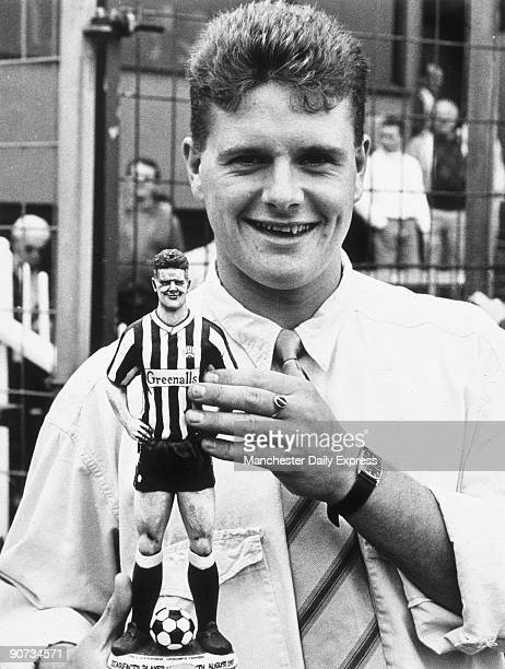 Paul Gascoigne holding a model of himself wearing a Newcastle United kit Gascoigne joined Newcastle United in 1983 and subsequently played for...