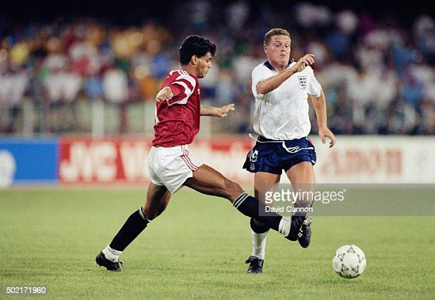 Paul Gascoigne of England is tripped by Hany Rahzy of Egypt during the 1990 FIFA World Cup match on June 21 1990 in Cagliari Italy