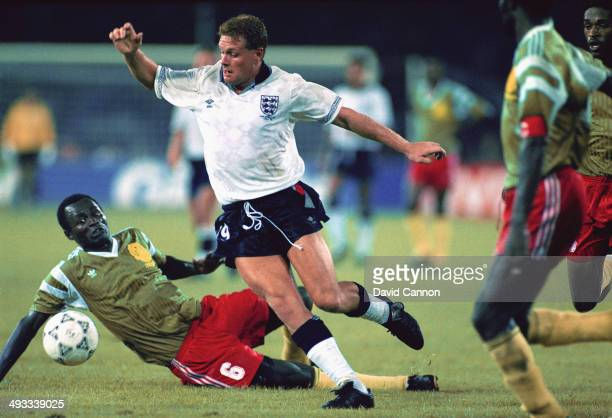 Paul Gascoigne of England jinks through the Cameroon defence during the FIFA World Cup Finals 1990 Quarter Final match between Cameroon and England...