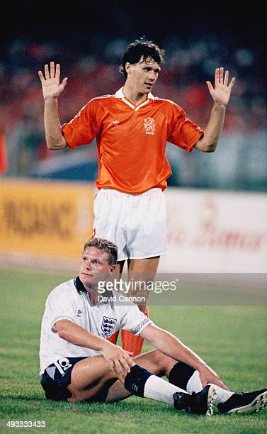 Paul Gascoigne of England looks on as Marco Van Basten of Holland reacts during the FIFA World Cup Finals 1990 group match between Holland and...
