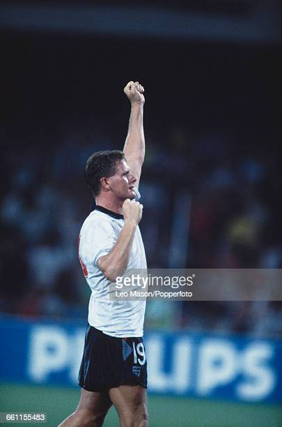 Paul Gascoigne of England raises his hand in the air during the 1990 FIFA World Cup quarterfinal game between Cameroon and England at the Stadio San...