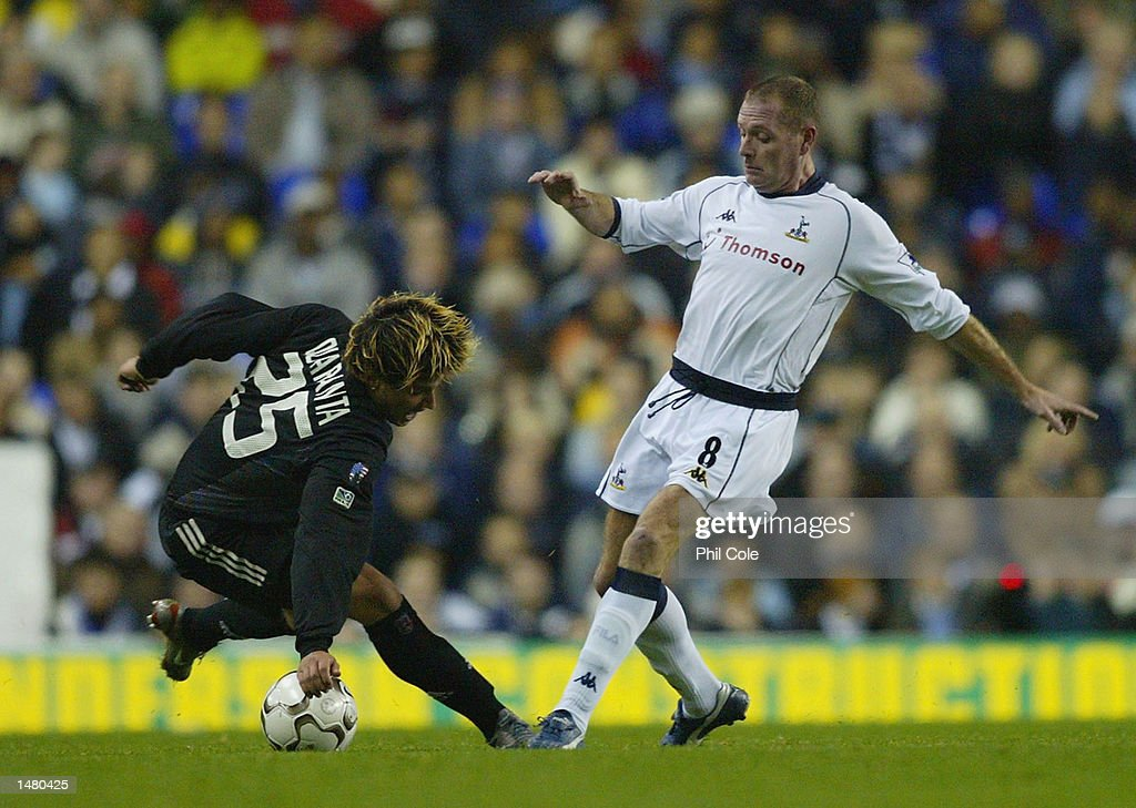 Paul Gascoigne of Tottenham Hotspur battles with Santino Quaranta of DC United during the Tottenham Hotspur Tribute match between Tottenham Hotspur and D.C. United at White Hart Lane in London on October 17, 2002.
