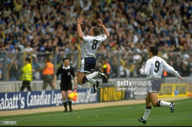 Paul Gascoigne of Tottenham Hotspur celebrates his 35 yard goal during the FA Cup Semi-Final against Arsenal at Wembley Stadium in London. Tottenham...