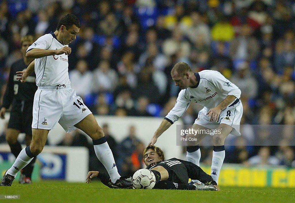 Paul Gascoigne of Tottenham Hotspur holds down Santino Quaranta of DC United in jest as Gustavo Poyet takes the ball during the Tottenham Hotspur Tribute match between Tottenham Hotspur and D.C. United at White Hart Lane in London on October 17, 2002.