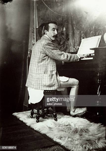 Paul Gauguin french painter playing harmonium without pants in Alphonse Mucha's studio Ca 1890