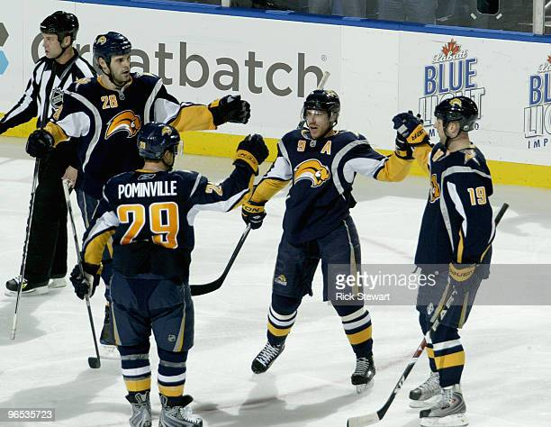Paul Gaustad Jason Pominville Derek Roy and Tim Connolly of the Buffalo Sabres celebrate Roy's goal in the second period against the Boston Bruins at...
