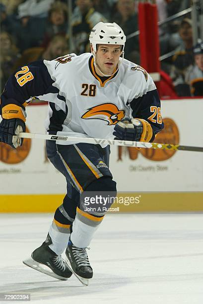 Paul Gaustad of the Buffalo Sabres skates against the Nashville Predators at Gaylord Entertainment Center on December 21, 2006 in Nashville,...