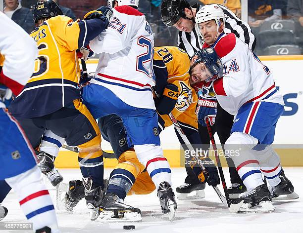 Paul Gaustad of the Nashville Predators battles in a face off against Tomas Plekanec of the Montreal Canadiens at Bridgestone Arena on December 21...