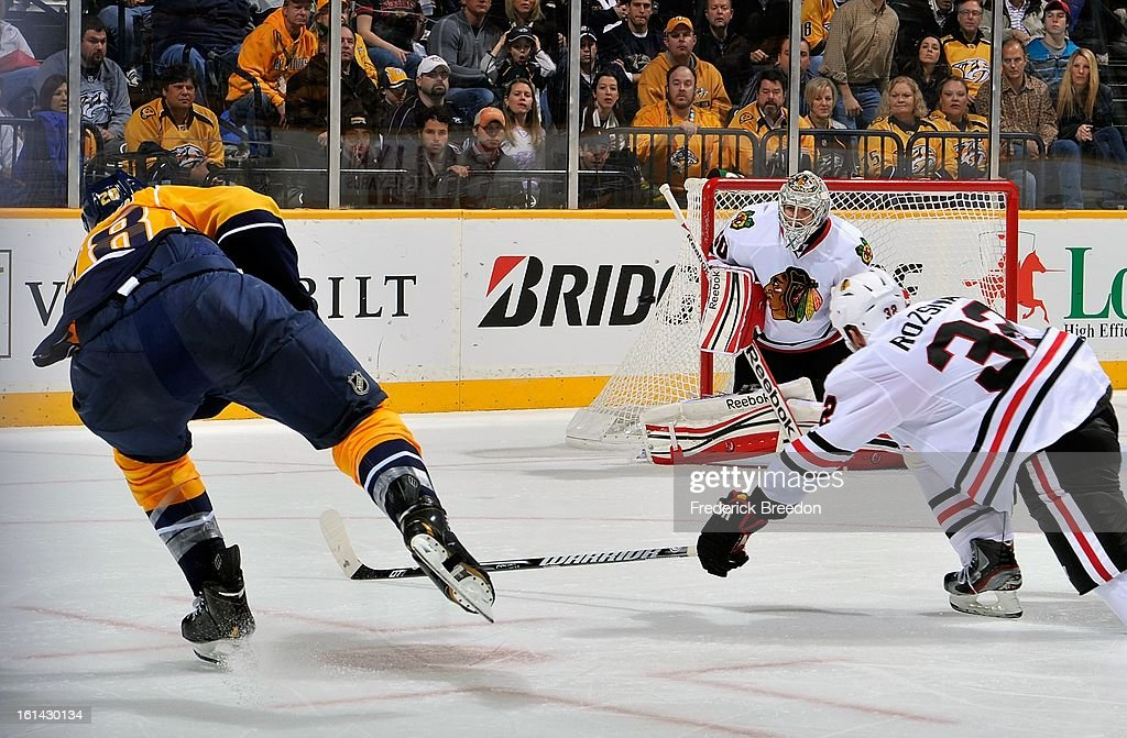 Paul Gaustad #28 of the Nashville Predators takes a shot on goalie Corey Crawford #50 of the Chicago Blackhawks at the Bridgestone Arena on February 10, 2013 in Nashville, Tennessee.