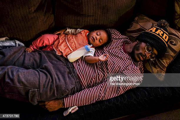 Paul Gayle and his 8monthold daughter Sapphire Gayle catch a quick nap at the home of the young father's 'best friend' Sly Nixon R on Monday April 27...