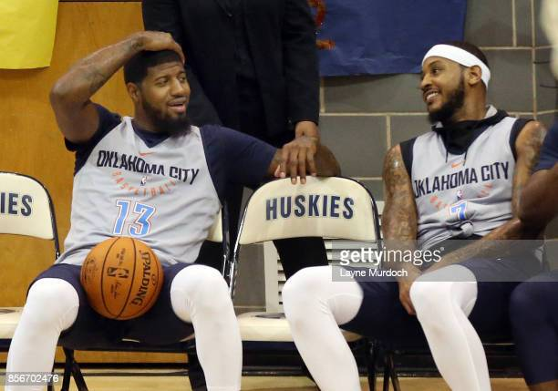 Paul George and Carmelo Anthony of the Oklahoma City Thunder and their team hold an open Blue/White scrimmage for fans on October 1 2017 at Edmond...