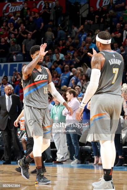Paul George and Carmelo Anthony of the Oklahoma City Thunder exchange a high five during the game against the LA Clippers on March 16 2018 at...