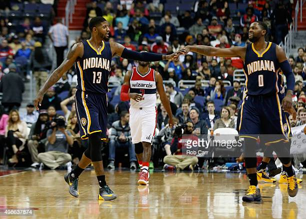 Paul George and CJ Miles of the Indiana Pacers celebrate during the closing minute of the Pacers 123106 win over the Washington Wizards at Verizon...