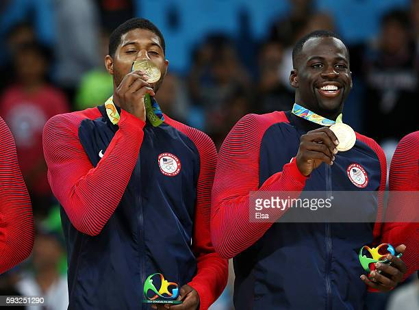 Paul George and Draymond Green stand on the podium with gold medals after defeating Serbia during the Men's Gold medal game on Day 16 of the Rio 2016...