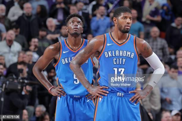 Paul George and Jerami Grant of the Oklahoma City Thunder face the Sacramento Kings on November 7 2017 at Golden 1 Center in Sacramento California...