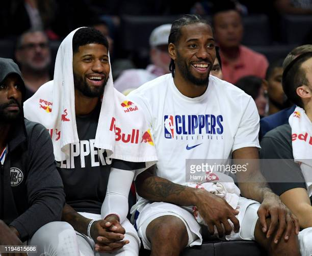 Paul George and Kawhi Leonard of the LA Clippers laugh on the bench during a 120-99 win over the Phoenix Suns at Staples Center on December 17, 2019...