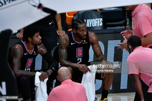 Paul George and Kawhi Leonard of the LA Clippers look on against the Denver Nuggets during Game Seven of the Western Conference SemiFinals of the NBA...