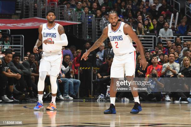 Paul George and Kawhi Leonard of the LA Clippers on guard during the game against the Boston Celtics on November 20 2019 at STAPLES Center in Los...