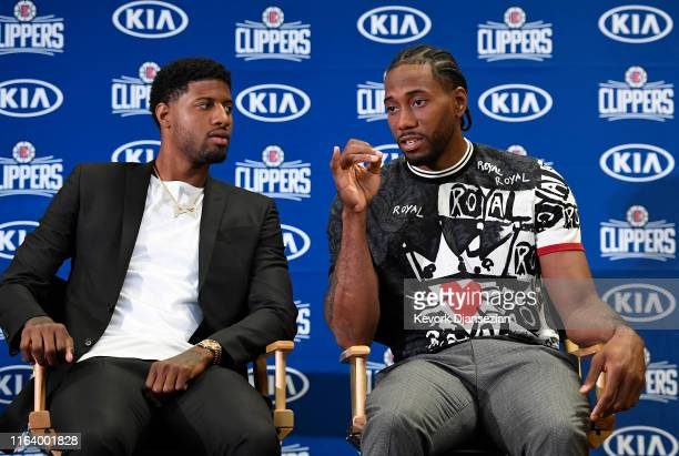 Paul George and Kawhi Leonard of the Los Angeles Clippers are introduced at Green Meadows Recreation Center on July 24 2019 in Los Angeles California...