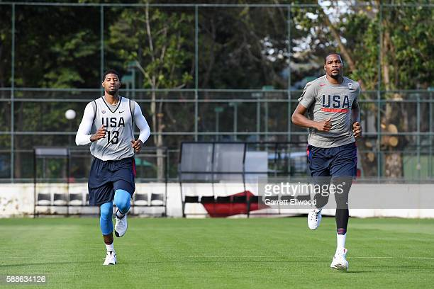 Paul George and Kevin Durant of the USA Basketball Men's National Team work out at a practice during the Rio 2016 Olympic Games on August 11 2016 at...