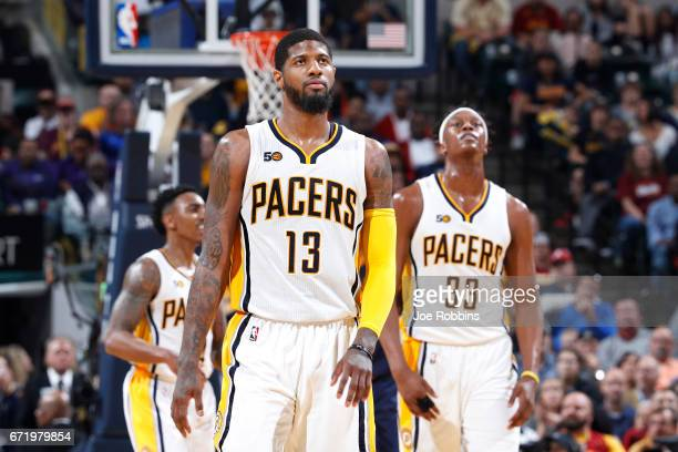 Paul George and Myles Turner of the Indiana Pacers react in the second half of Game Four of the Eastern Conference Quarterfinals during the 2017 NBA...