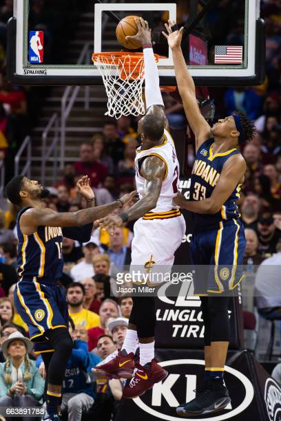 Paul George and Myles Turner of the Indiana Pacers try to stop LeBron James of the Cleveland Cavaliers during the first half at Quicken Loans Arena...