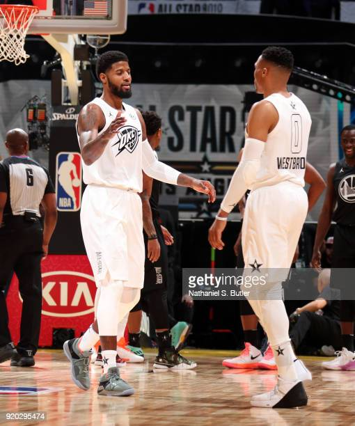 Paul George and Russell Westbrook of Team LeBron high five during the game against Team Stephen during the NBA AllStar Game as a part of 2018 NBA...