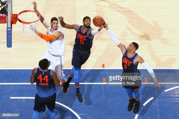 Paul George and Russell Westbrook of the Oklahoma City Thunder jump for the rebound against the New York Knicks on December 16 2017 at Madison Square...