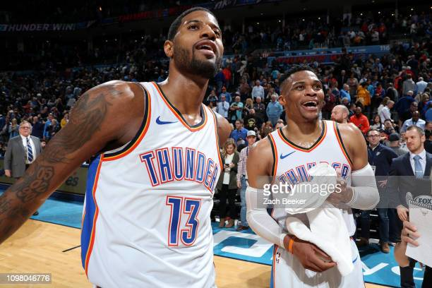 Paul George and Russell Westbrook of the Oklahoma City Thunder look on after the game against the Portland Trail Blazers on February 11 2019 at...