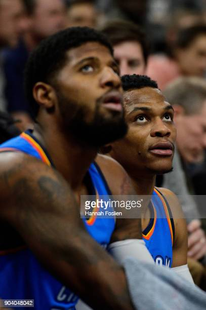 Paul George and Russell Westbrook of the Oklahoma City Thunder look on during a timeout in the game against the Minnesota Timberwolves on January 10...