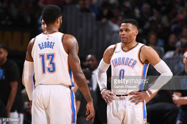Paul George and Russell Westbrook of the Oklahoma City Thunder look on during the game against the Denver Nuggets on February 1 2018 at the Pepsi...