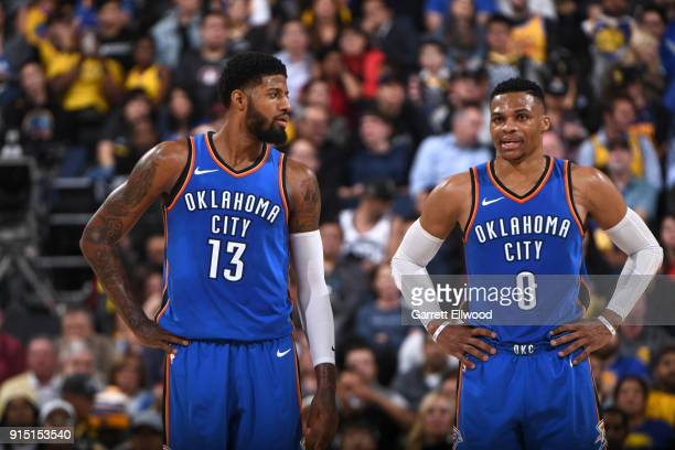 Paul George and Russell Westbrook of the Oklahoma City Thunder look on during the game against the Golden State Warriors on February 6 2018 at ORACLE...