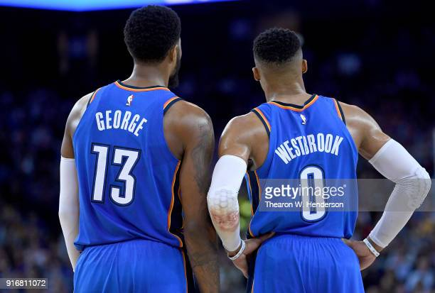 Paul George and Russell Westbrook of the Oklahoma City Thunder looks on against the Golden State Warriors during the second half of their NBA...