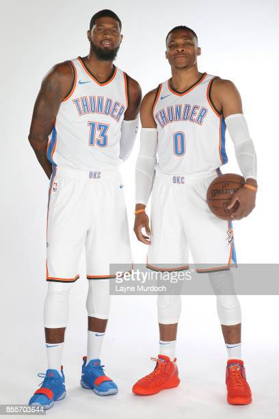 Paul George and Russell Westbrook of the Oklahoma City Thunder pose for a portrait during 2017 NBA Media Day on September 25 2017 at the Chesapeake...