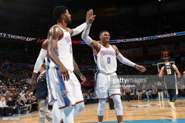 Paul George and Russell Westbrook of the Oklahoma City Thunder react during the game against the Denver Nuggets on December 18 2017 at Chesapeake...