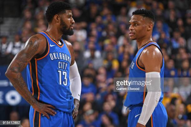 Paul George and Russell Westbrook of the Oklahoma City Thunder talk on the court during the game against the Golden State Warriors on February 6 2018...