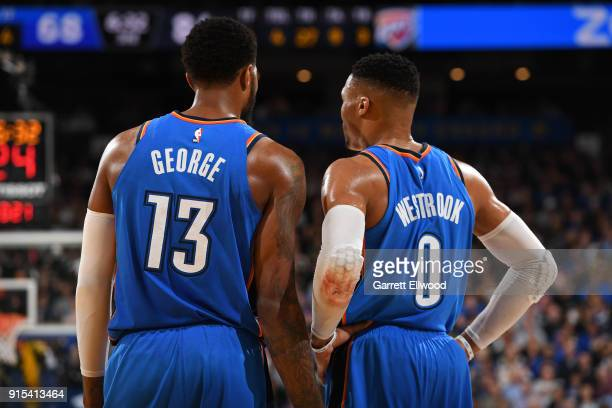Paul George and Russell Westbrook of the Oklahoma City Thunder talk during the game against the Golden State Warriors on February 6 2018 at ORACLE...