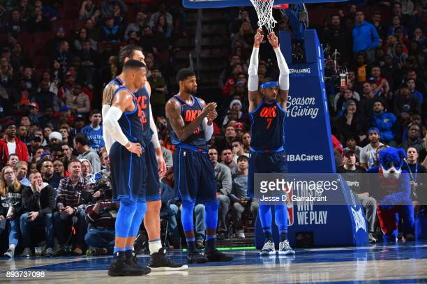 Paul George Carmelo Anthony and Russell Westbrook of the Oklahoma City Thunder look on against the Philadelphia 76ers at Wells Fargo Center on...