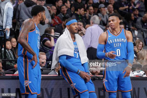Paul George Carmelo Anthony and Russell Westbrook of the Oklahoma City Thunder talk during the game against the Sacramento Kings on February 22 2018...