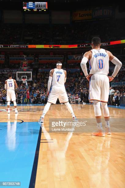 Paul George Carmelo Anthony and Russell Westbrook of the Oklahoma City Thunder stand on the court during the game against the Miami Heat on March 23...