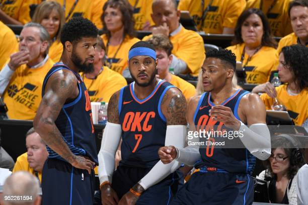Paul George Carmelo Anthony and Russell Westbrook of the Oklahoma City Thunder in Game Six of the Western Conference Quarterfinals against the Utah...