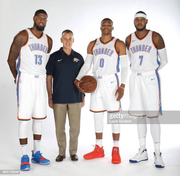Paul George head coach Billy Donovan Russell Westbrook and Carmelo Anthony of the Oklahoma City Thunder pose for a portrait during the 2017 NBA Media...