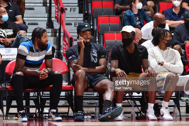 Paul George, Kawhi Leonard, Reggie Jackson, and Terance Mann of the LA Clippers look on during the 2021 Las Vegas Summer League on August 9, 2021 at...