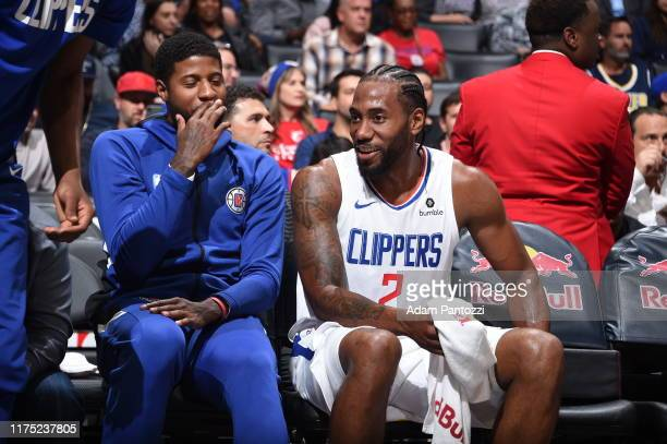 Paul George of the LA Clippers and Kawhi Leonard of the LA Clippers shares a laugh during the game against the Denver Nuggets during the preseaspn on...