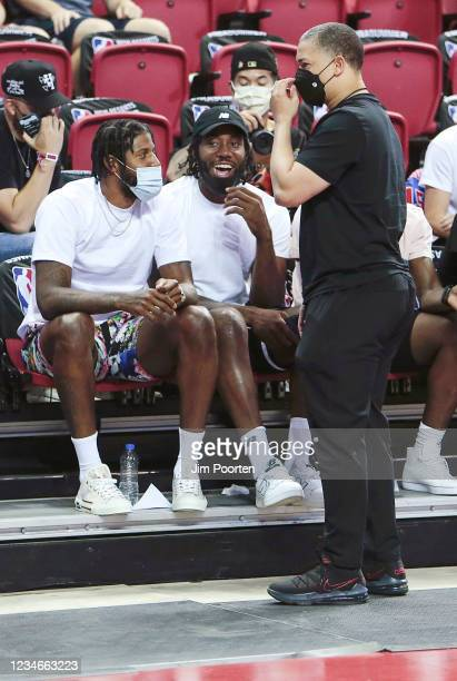 Paul George of the LA Clippers and Kawhi Leonard of the LA Clippers talks to Head Coach Tyronn Lue of the Los Angeles Clippers during the 2021 Las...