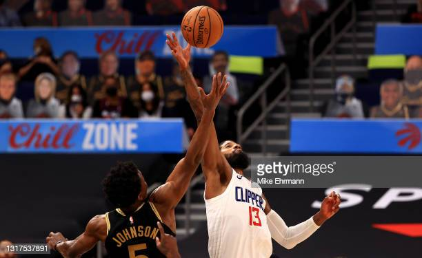 Paul George of the LA Clippers and Stanley Johnson of the Toronto Raptors jump ball during a game at Amalie Arena on May 11, 2021 in Tampa, Florida....