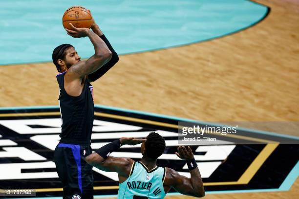 Paul George of the LA Clippers attempts a shot against Terry Rozier of the Charlotte Hornets during the second quarter of their game at Spectrum...