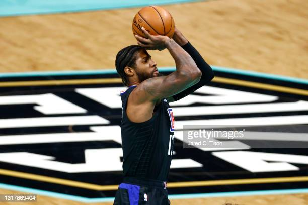 Paul George of the LA Clippers attempts a shot during the first quarter of their game against the Charlotte Hornets at Spectrum Center on May 13,...