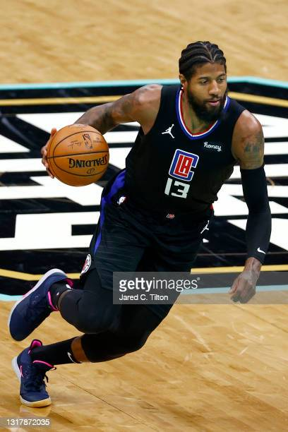 Paul George of the LA Clippers dribbles during the second quarter of their game against the Charlotte Hornets at Spectrum Center on May 13, 2021 in...